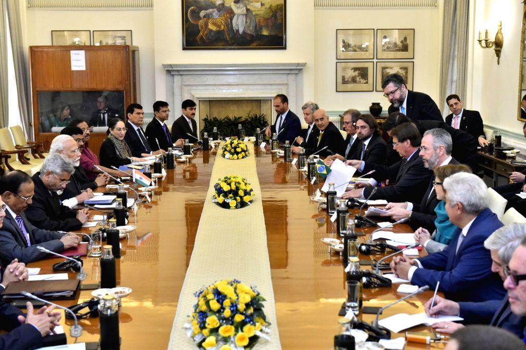 Prime Minister Narendra Modi and Brazilian President Jair Bolsonaro during delegation level talks at Hyderabad House in New Delhi on Jan 25, 2020. - Narendra Modi