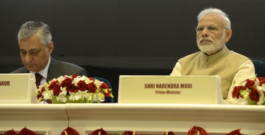 Prime Minister Narendra Modi and Chief Justice of India Justice TS Thakur at the 50th anniversary function of establishment of the Delhi High Court, in New Delhi on Oct 31, 2016. - Narendra Modi