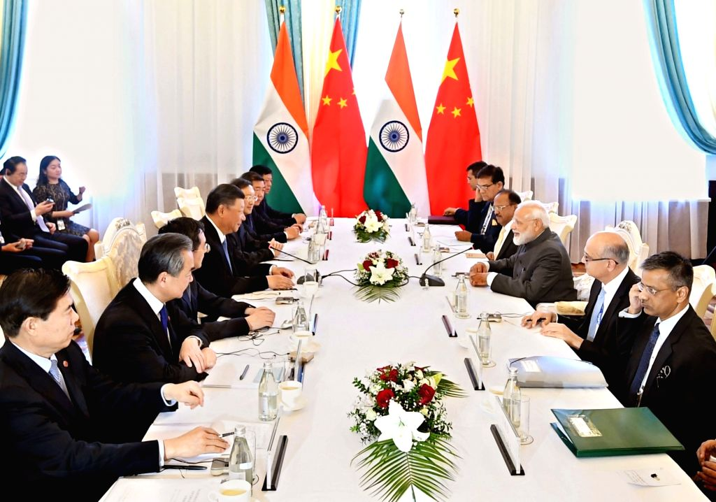 Prime Minister Narendra Modi and Chinese President Xi Jinping during a meeting on the sidelines of the SCO Summit in Bishkek, Kyrgyz Republic on June 13, 2019. - Narendra Modi