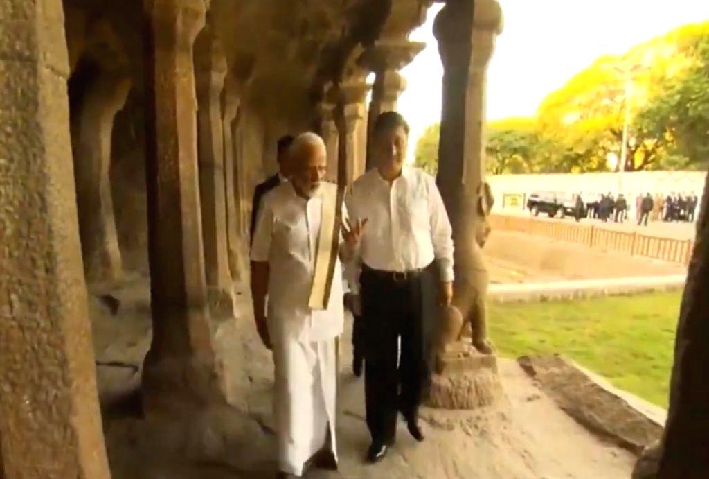 Prime Minister Narendra Modi and Chinese President Xi Jinping during their visit to Varaha Cave Temple in Mahabalipuram, Tamil Nadu on Oct 11, 2019. - Narendra Modi