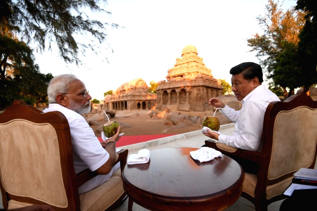 Prime Minister Narendra Modi and Chinese President Xi Jinping enjoy coconut water as they share a conversation during their visit to Pancha Rathas complex in Mahabalipuram, Tamil Nadu ... - Narendra Modi