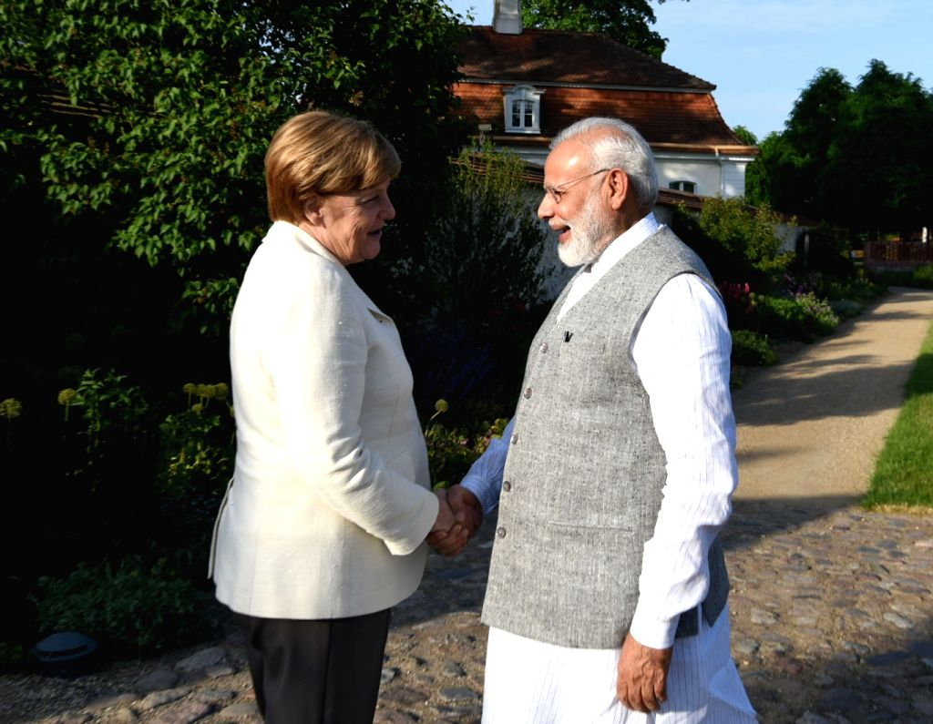 Prime Minister Narendra Modi and German Chancellor  Angela Merkel during a meeting at Schloss Meseberg in Berlin, Germany on May 29, 2017. - Narendra Modi