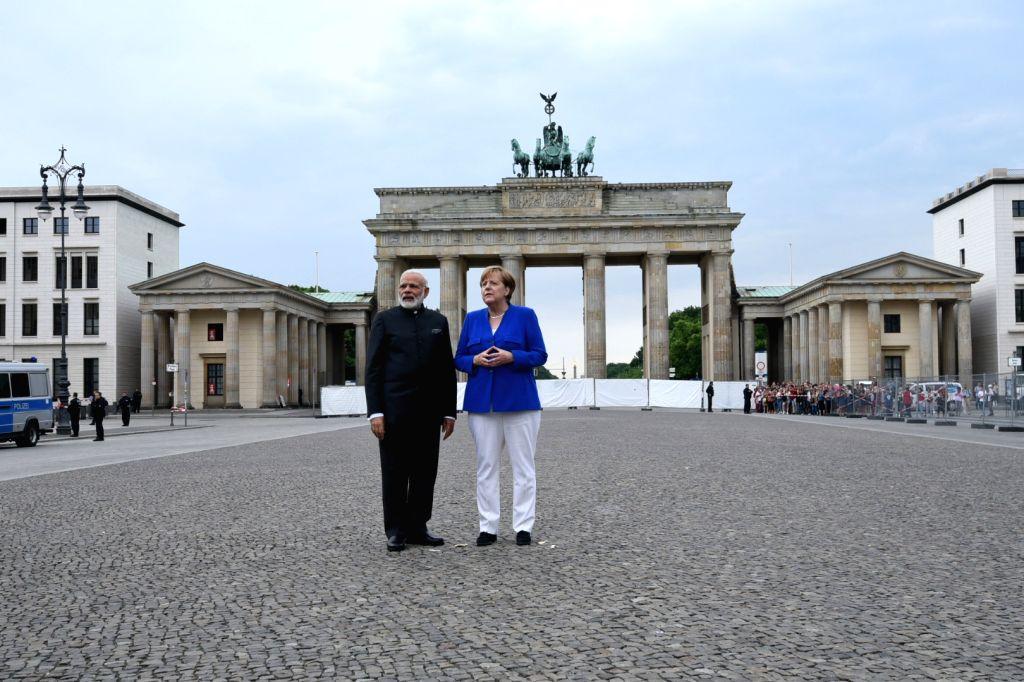 Prime Minister Narendra Modi and German Chancellor Dr. Angela Merkel at Berlin's Brandenburg Gate, Germany on May 30, 2017. - Narendra Modi