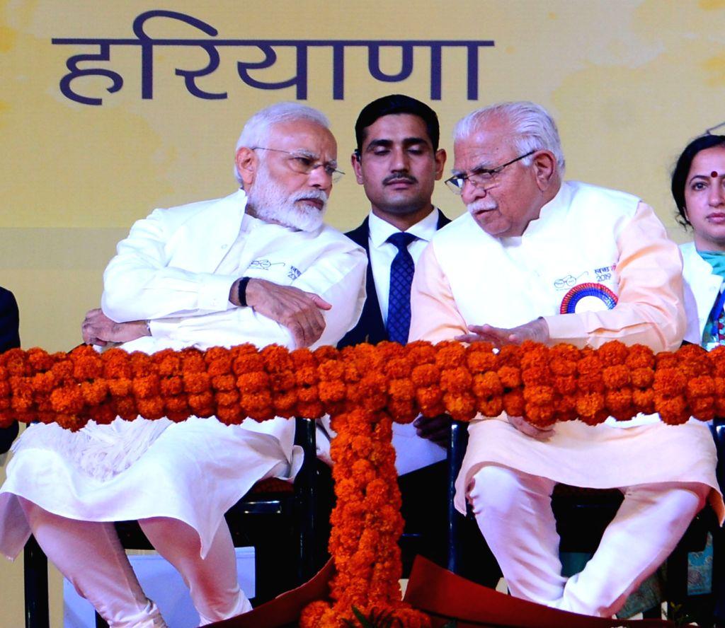 Prime Minister Narendra Modi and Haryana Chief Minister Manohar Lal Khattar addresses at the launch of Swachh Shakti-2019 programme in Kurukshetra on Feb 12, 2019. - Narendra Modi and Manohar Lal Khattar
