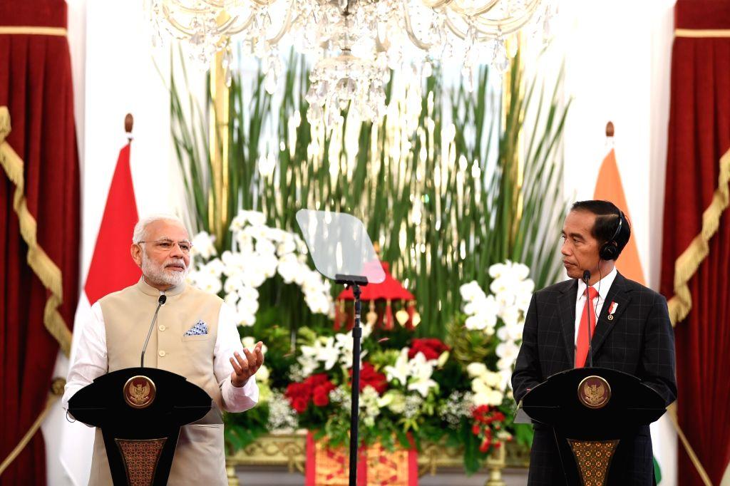 Prime Minister Narendra Modi and Indonesian President Joko Widodo issue a Joint Press Statement at Istana Merdeka, in Jakarta, Indonesia on May 30, 2018. - Narendra Modi