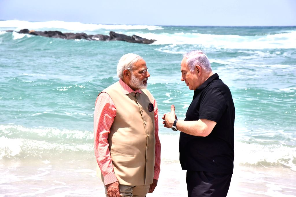Prime Minister Narendra Modi and Israeli Prime Minister Benjamin Netanyahu at the Olga Beach in Israel on July 6, 2017. - Narendra Modi