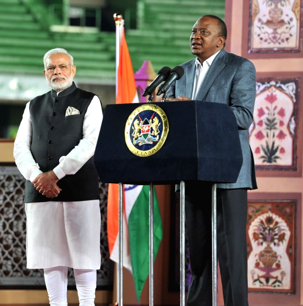Prime Minister Narendra Modi and Kenyan President Uhuru Kenyatta during a Community Reception event, at Kasarani Stadium, in Nairobi, Kenya on July 10, 2016. - Narendra Modi