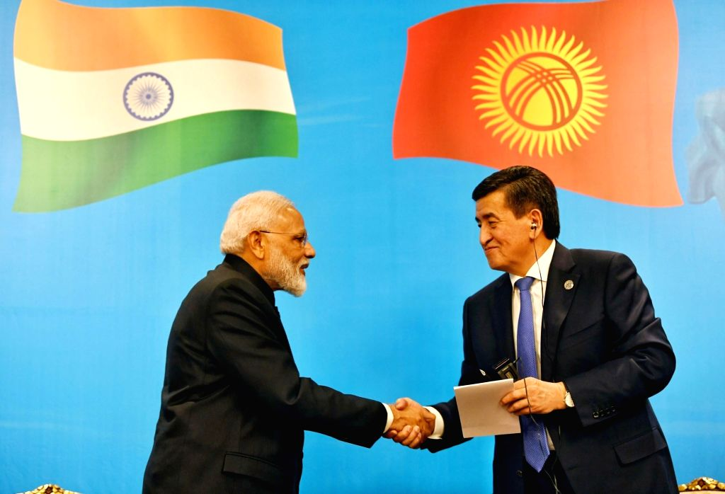 Prime Minister Narendra Modi and Kyrgyzstan President Sooronbay Jeenbekov at the inauguration of India-Kyrgy Business Forum in Bishkek, Kyrgyzstan on June 14, 2019. - Narendra Modi