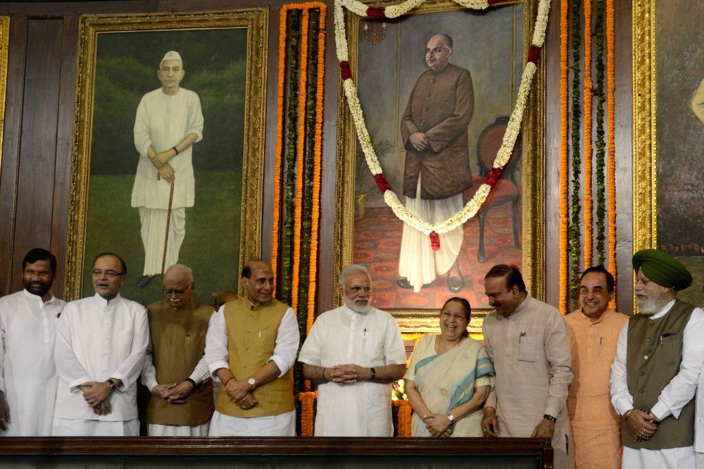 Prime Minister Narendra Modi and Lok Sabha Speaker Sumitra Mahajan with Union Ministers Rajnath Singh, Arun Jaitley, Ramvilas Paswan, Ananth Kumar, S.S. Ahluwalia and BJP veterans L K ... - Narendra Modi, Ministers Rajnath Singh, Arun Jaitley, Ramvilas Paswan, Ananth Kumar, S., Sumitra Mahajan and L K Advani