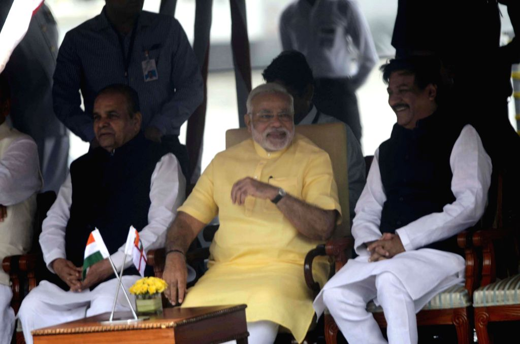 Prime Minister Narendra Modi and Maharashtra Chief Minister Prithviraj Chavan during the commissioning ceremony of INS Kolkata at the Naval Dockyard in Mumbai on August 16, 2014. - Narendra Modi
