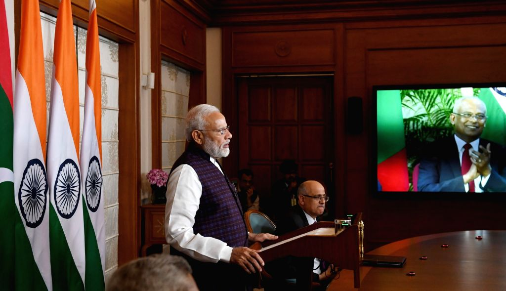 Prime Minister Narendra Modi and Maldives President Ibrahim Mohamed Solih jointly inaugurate the key development projects in Maldives via video conference, in New Delhi on Dec 4, 2019. - Narendra Modi