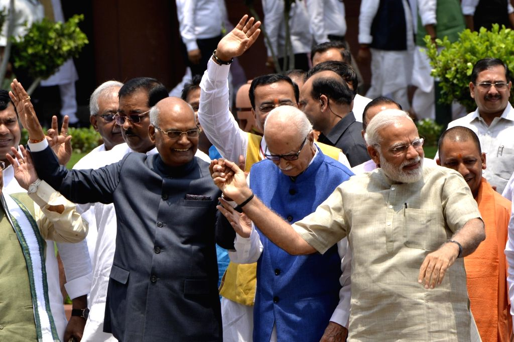 Prime Minister Narendra Modi and NDA presidential candidate Ram Nath Kovind with BJP leader LK Advani at Parliament in New Delhi on June 23, 2017. Kovind filed his nomination for the July ... - Narendra Modi and Nath Kovind