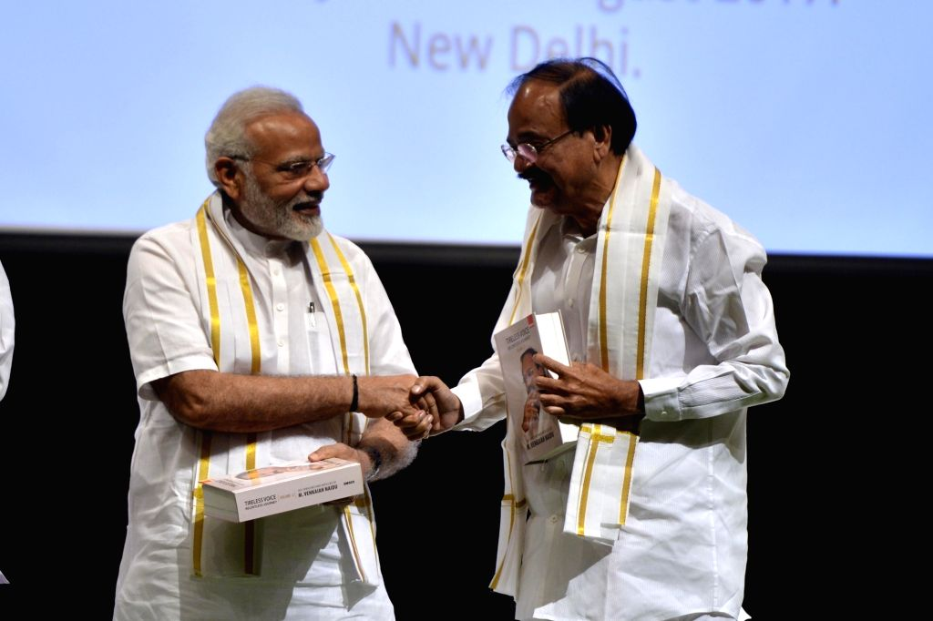 """Prime Minister Narendra Modi and NDA's Vice-Presidential candidate Venkaiah Naidu during the release of a book """"Tireless Voice Relentless Journey"""" written by NDA's ... - Narendra Modi and Venkaiah Naidu"""