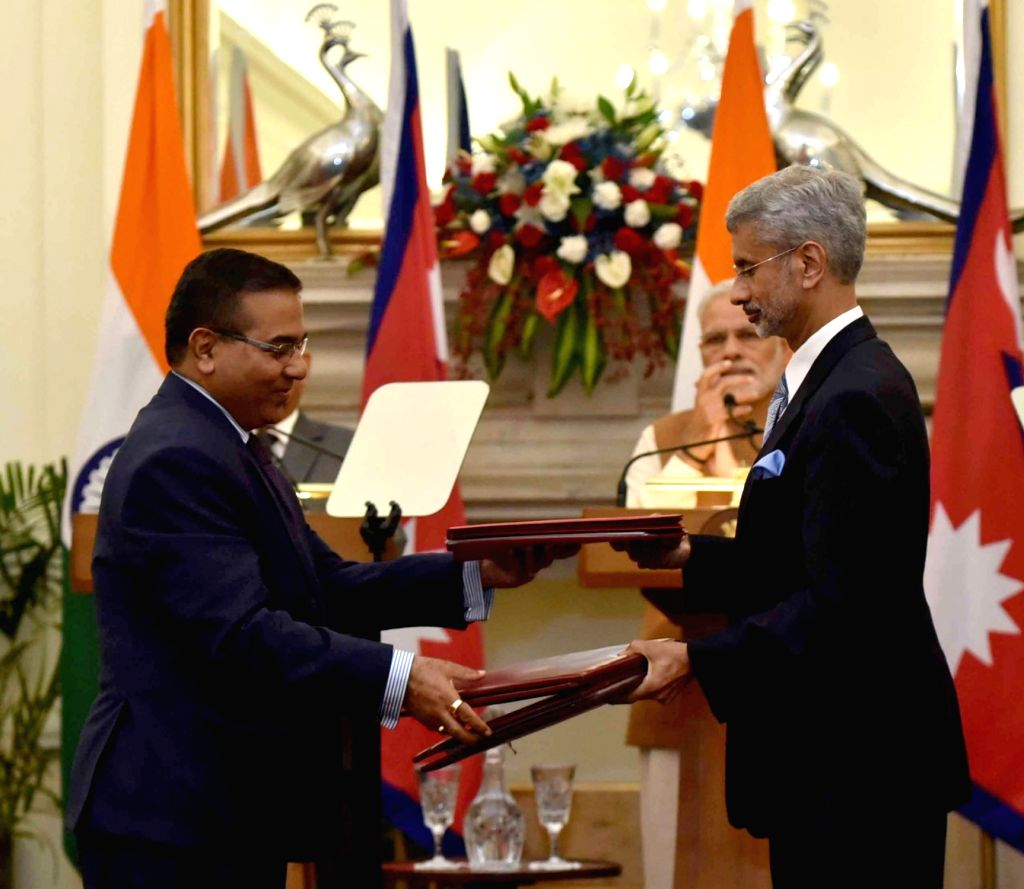 Prime Minister Narendra Modi and Nepalese Prime Minister Pushpa Kamal Dahal witnesses the exchange of agreements, at Hyderabad House, in New Delhi on Sept 16, 2016. Also seen Foreign ... - Narendra Modi