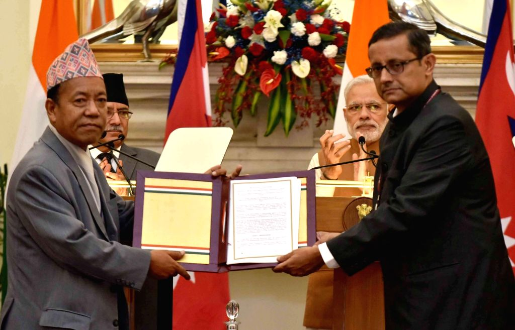 Prime Minister Narendra Modi and Nepalese Prime Minister Pushpa Kamal Dahal witnesses the exchange of agreements, at Hyderabad House, in New Delhi on Sept 16, 2016. - Narendra Modi