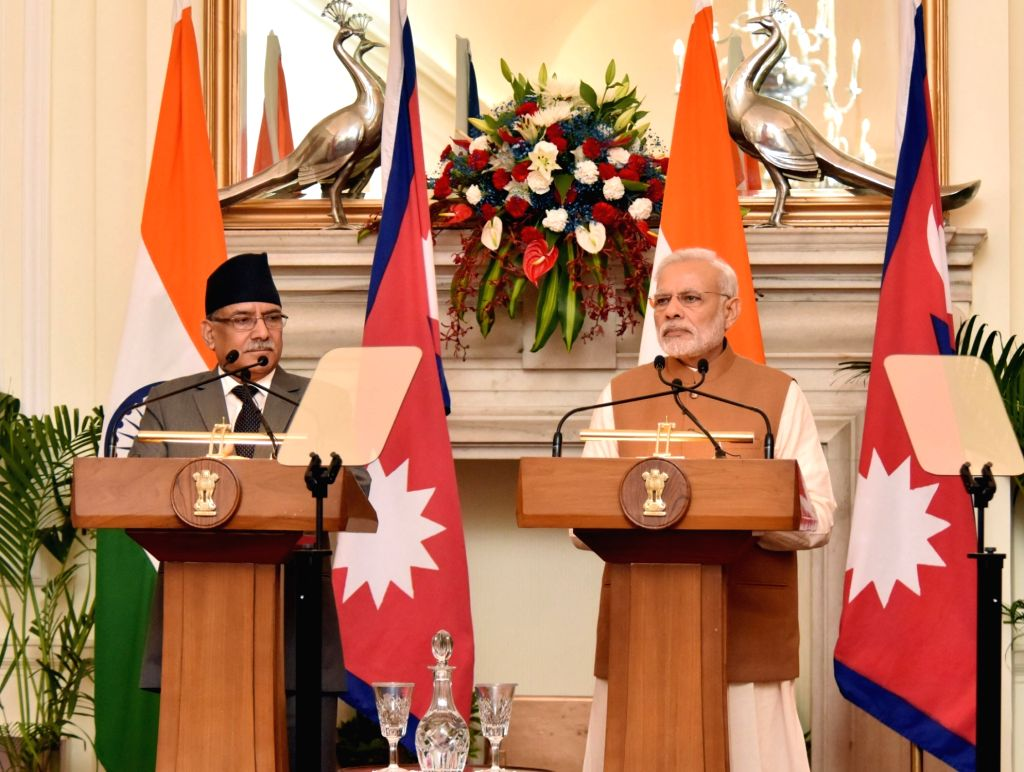 Prime Minister Narendra Modi and Nepalese Prime Minister Pushpa Kamal Dahal during a Joint Press Conference at Hyderabad House, in New Delhi on Sept 16, 016. - Narendra Modi