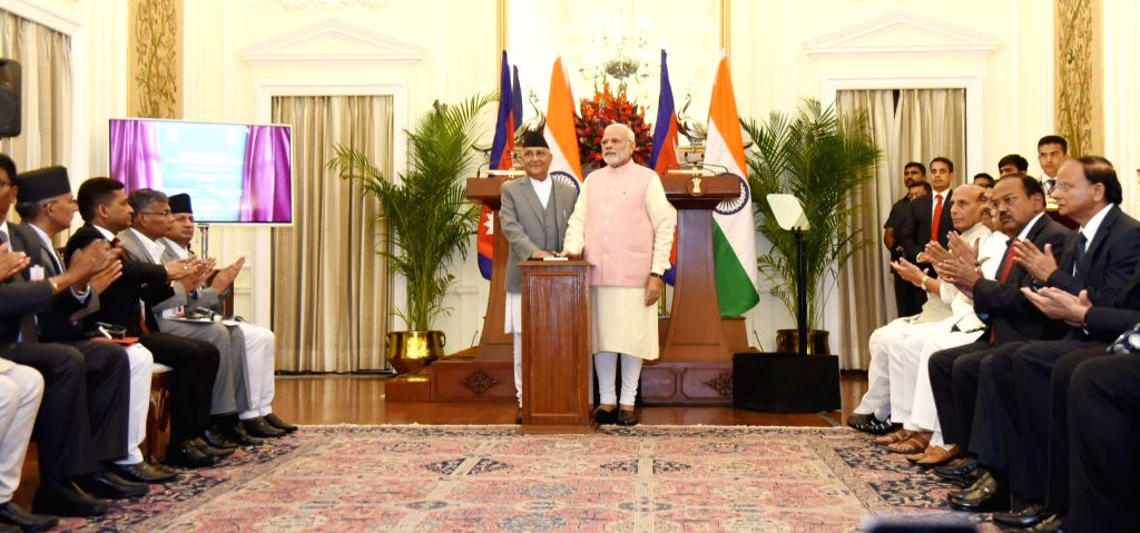 Prime Minister Narendra Modi and Nepalese Prime Minister K.P. Sharma Oli inaugurate India-Nepal oil products pipeline and other development projects at Hyderabad House in New Delhi on ... - Narendra Modi and P. Sharma Oli