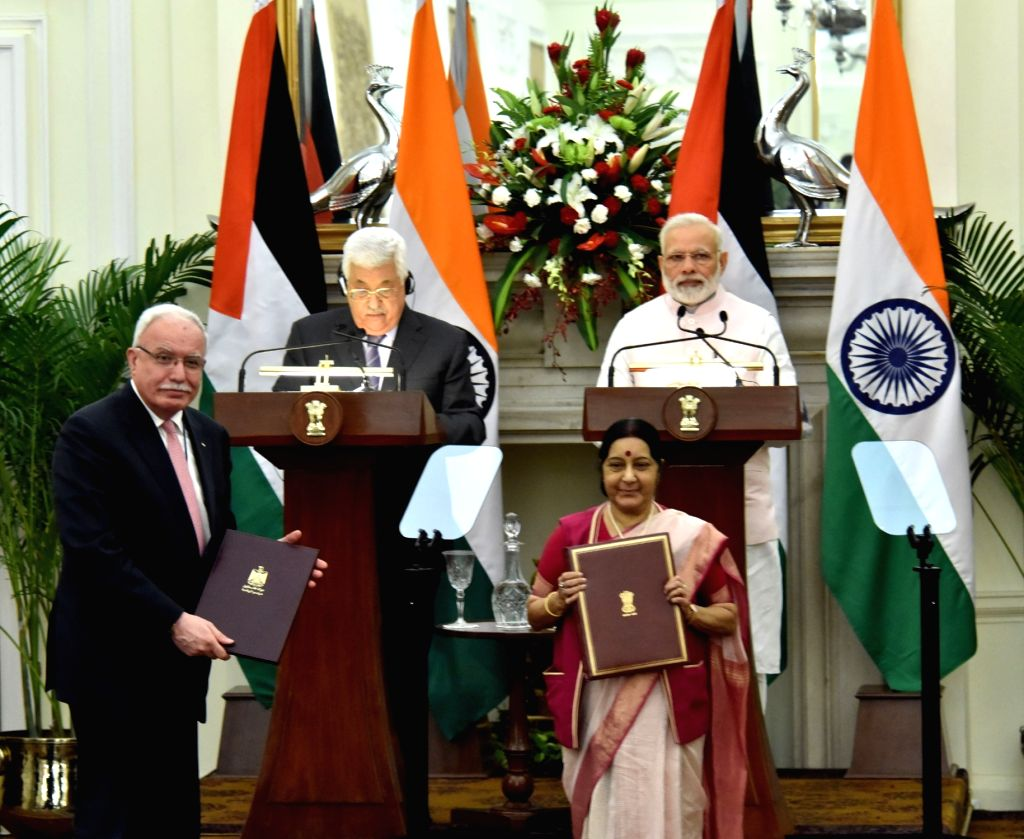 Prime Minister Narendra Modi and Palestine President Mahmoud Abbas witness the exchange of agreements at Hyderabad House in New Delhi on May 16, 2017. Also seen External Affairs Minister ... - Narendra Modi and Sushma Swaraj