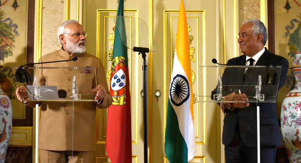 Prime Minister Narendra Modi and Portuguese counterpart Antonio Costa at the Joint Press Statements; in Lisbon, Portugal on June 24, 2017. - Narendra Modi