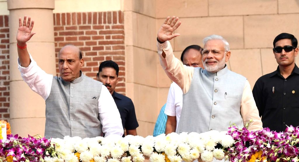"Prime Minister Narendra Modi and Rajnath Singh during a programme organised to flag off ""Run for Unity"" on Rashtriya Ekta Diwas at National Stadium in New Delhi on Oct 31, 2016. - Narendra Modi and Rajnath Singh"