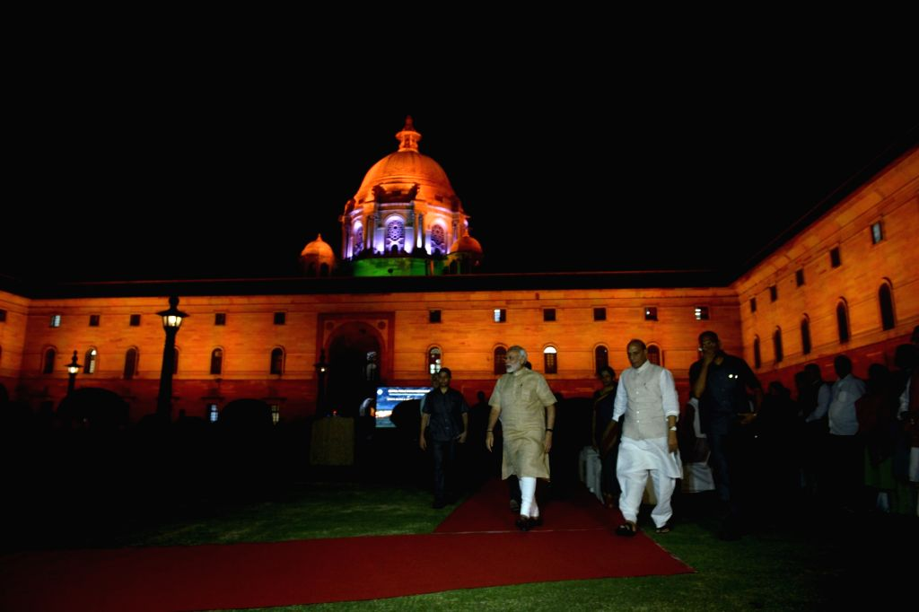Prime Minister Narendra Modi and Rajnath Singh after inauguration of new dynamic facade lighting, installed by the Ministry of Housing and Urban Affairs at the North and South Block on the ... - Narendra Modi, Rajnath Singh and Mahipal Singh