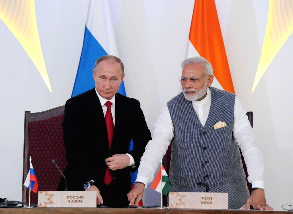 Prime Minister Narendra Modi and Russian President Vladimir Putin witness the laying of Foundation Concrete of the Kudankulam Nuclear Power Plant Units-3 and 4 in Goa on Oct 15, 2016. - Narendra Modi