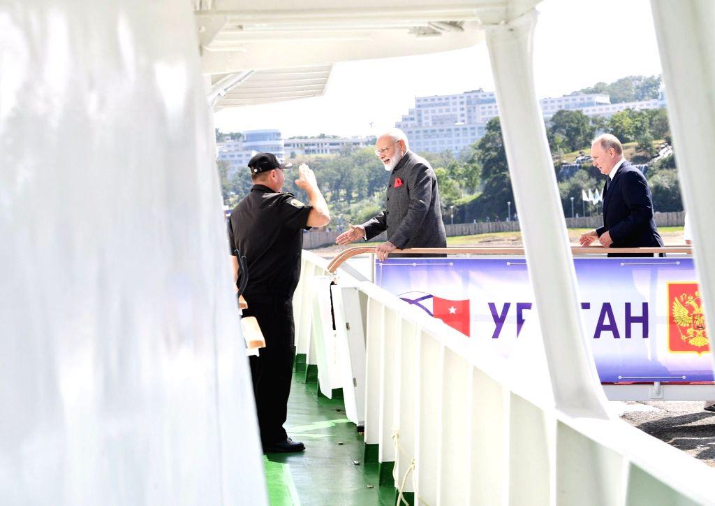 Prime Minister Narendra Modi and Russian President Putin board a ship to 'Zvezda' Shipbuilding Complex in Russia on Sep 4, 2019. - Narendra Modi