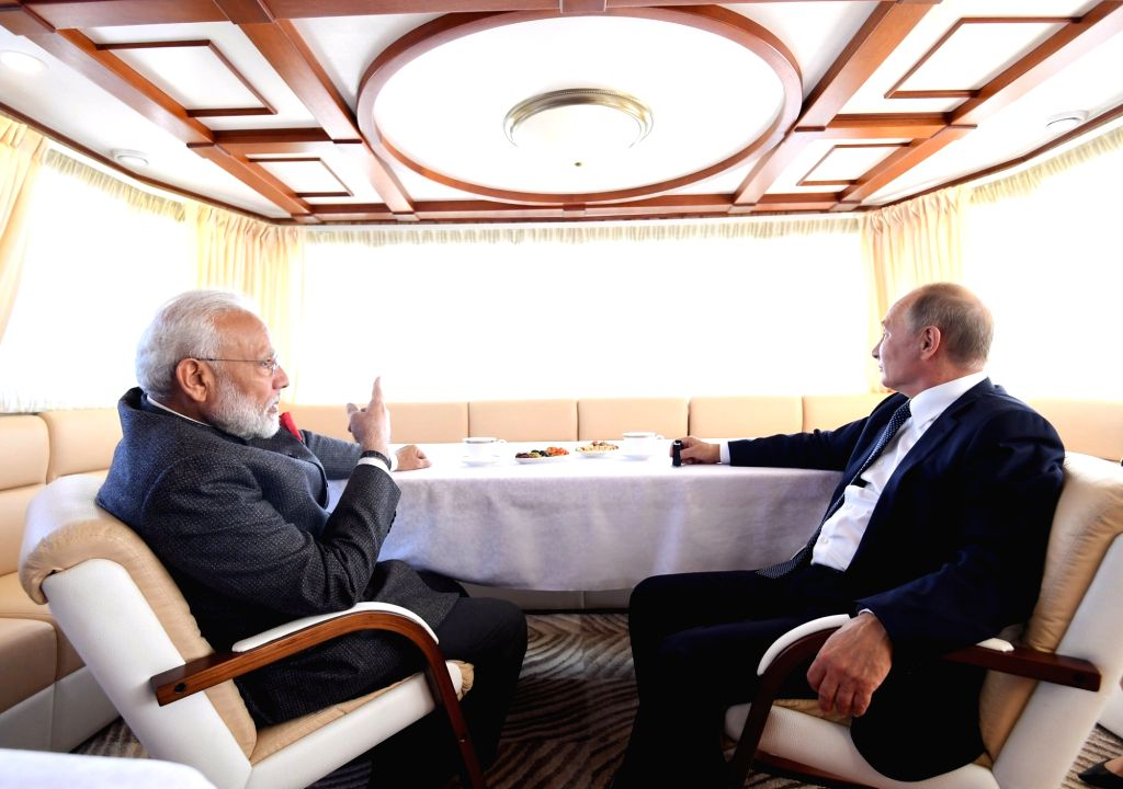 Prime Minister Narendra Modi and Russian President Putin onboard a ship on their way to 'Zvezda' Shipbuilding Complex in Russia on Sep 4, 2019. - Narendra Modi