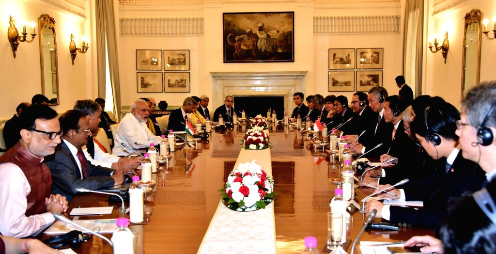 Prime Minister Narendra Modi and Singapore Prime Minister Lee Hsien Loong during the delegation level talks at Hyderabad House in New Delhi on Oct 4, 2016. - Narendra Modi