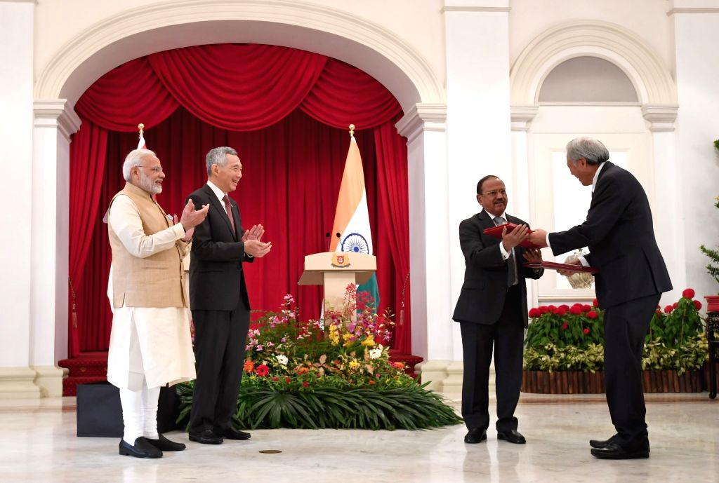 Prime Minister Narendra Modi and Singapore Prime Minister Lee Hsien Loong witness the exchange of MoUs at Istana - Presidential Palace in Singapore on June 1, 2018. - Narendra Modi
