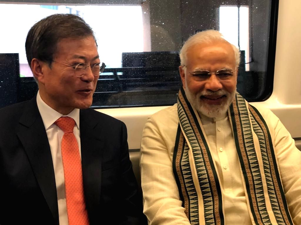 Prime Minister Narendra Modi and South Korean President Moon Jae-in travel in the Delhi metro as they head to Noida, for the inauguration of the new 35-acre Samsung Electronics facility - ... - Narendra Modi
