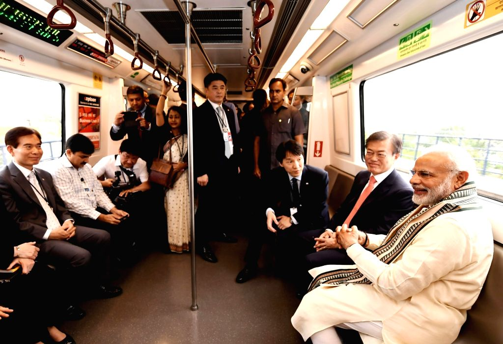 Prime Minister Narendra Modi and South Korean President Moon Jae-in take Delhi Metro ride on the way to inaugurate the Samsung manufacturing plant - world's largest mobile factory in ... - Narendra Modi
