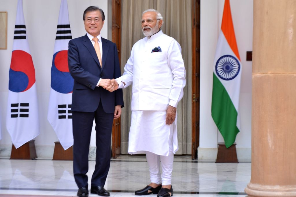 Prime Minister Narendra Modi and South Korean President Moon Jae-in head for a meeting at Hyderabad House, in New Delhi on July 10, 2018. - Narendra Modi