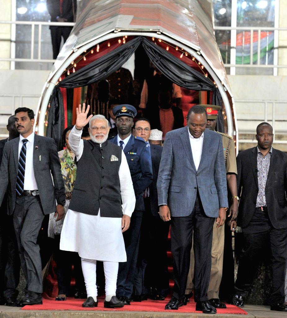 Prime Minister Narendra Modi and the Kenyan President Uhuru Kenyatta arrive at the Community Reception, at Kasarani Stadium, in Nairobi, Kenya on July 10, 2016. - Narendra Modi