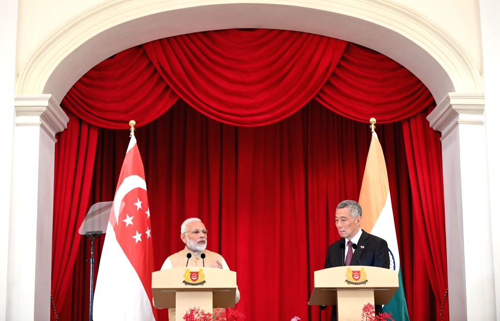 Prime Minister Narendra Modi and the Prime Minister of Singapore Lee Hsien Loong at the Joint Media Statement, at Istana - Presidential Palace, in Singapore on June 01, 2018. - Narendra Modi