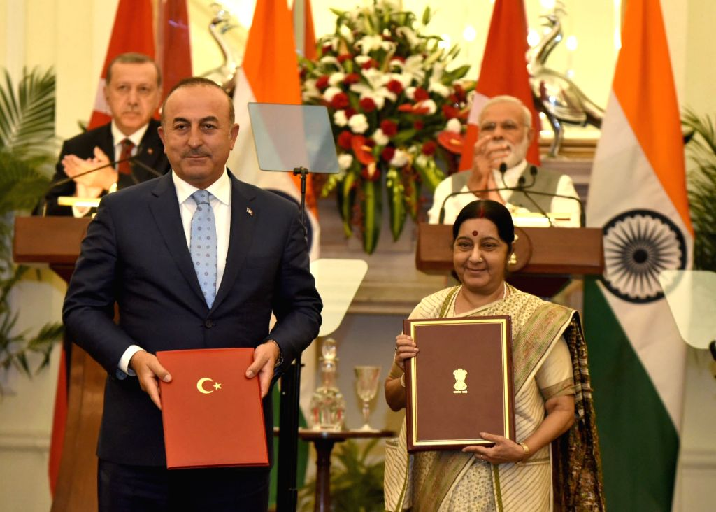 Prime Minister Narendra Modi and Turkey President Recep Tayyip Erdogan witness the exchange of agreements between India and Turkey at Hyderabad House in New Delhi on May 1, 2017. Also seen ... - Narendra Modi and Sushma Swaraj