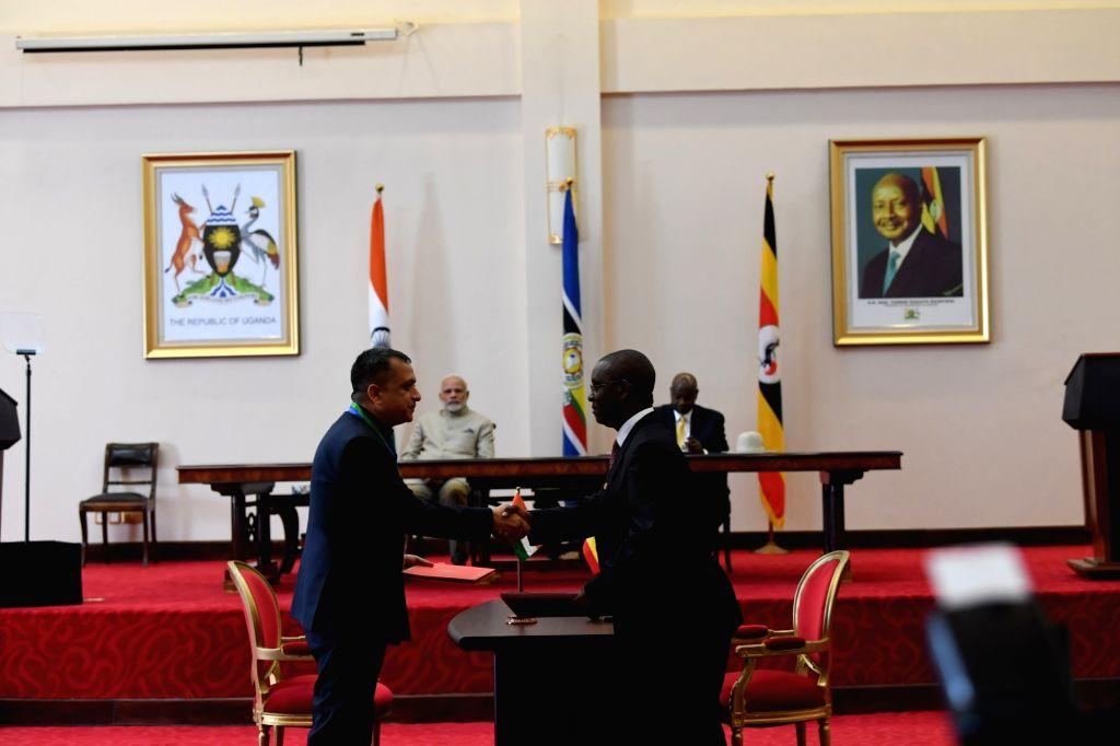 Prime Minister Narendra Modi and Uganda President Yoweri Museveni witness exchange of agreements at the State House in Kampala, Uganda on July 24, 2018. - Narendra Modi