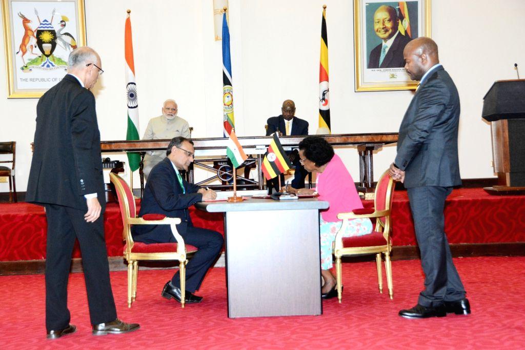 Prime Minister Narendra Modi and Uganda President Yoweri Museveni witness signing of agreements at the State House in Kampala, Uganda on July 24, 2018. - Narendra Modi