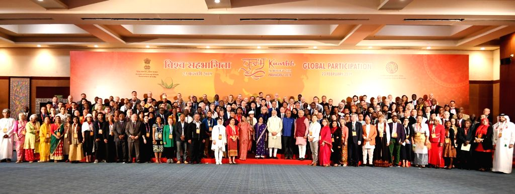 Prime Minister Narendra Modi and Union External Affairs Minister Sushma Swaraj and other dignitaries in a group photograph with the Pravasi Bhartiya representatives from various countries ... - Narendra Modi and Sushma Swaraj