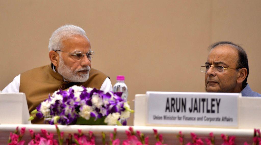 Prime Minister Narendra Modi and Union Finance Minister Arun Jaitley. (Photo: IANS) - Narendra Modi and Arun Jaitley