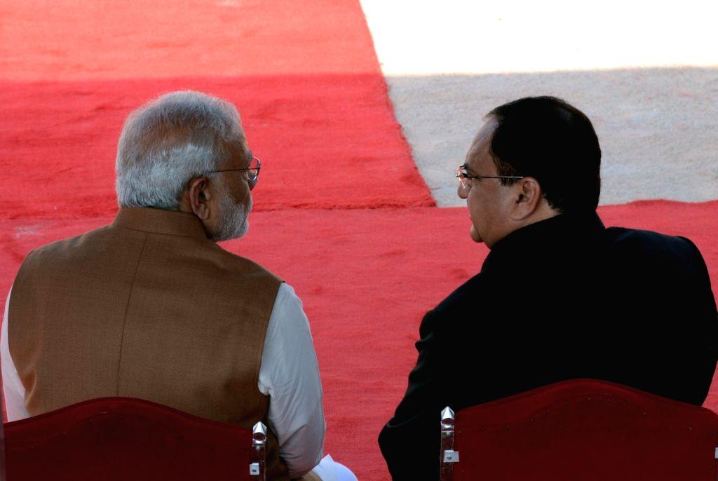 Prime Minister Narendra Modi and Union Health Minister JP Nadda during the ceremonial reception organised for  Nepalese Prime Minister Pushpa Kamal Dahal at Rashtrapati Bhavan in New Delhi ... - Narendra Modi