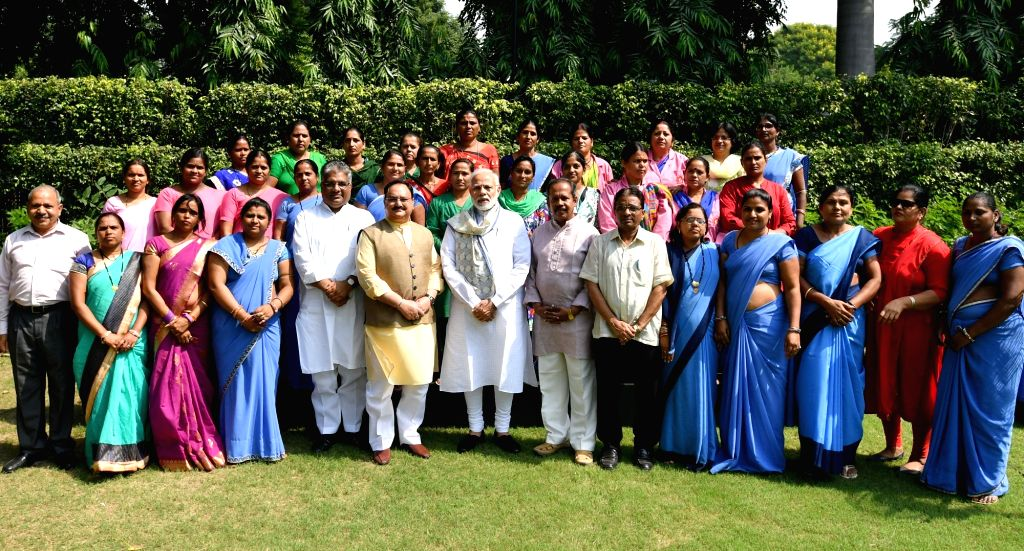 Prime Minister Narendra Modi and Union Health and Family Welfare Minister J.P. Nadda with the Accredited Social Health Activist (ASHA) representatives from across the country, in New Delhi ... - Narendra Modi