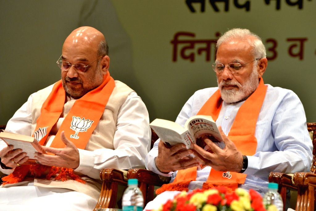 Prime Minister Narendra Modi and Union Home Minister Amit Shah during the two-day compulsory orientation programme 'Abhyas Varga' organised for all the newly-elected Members of Parliament ... - Narendra Modi and Amit Shah