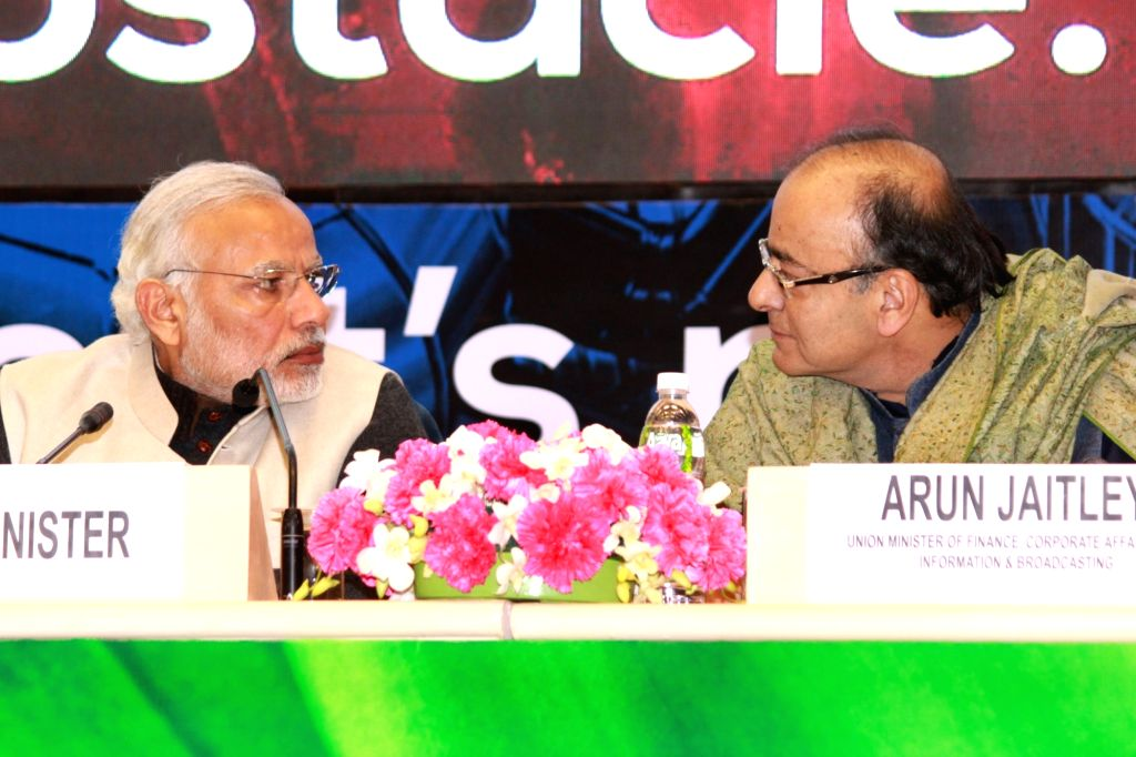 Prime Minister Narendra Modi and Union Minister for Finance, Corporate Affairs and Information and Broadcasting Arun Jaitley at the launch of `Start Up India`, in New Delhi on Jan 16, ... - Narendra Modi and Arun Jaitley