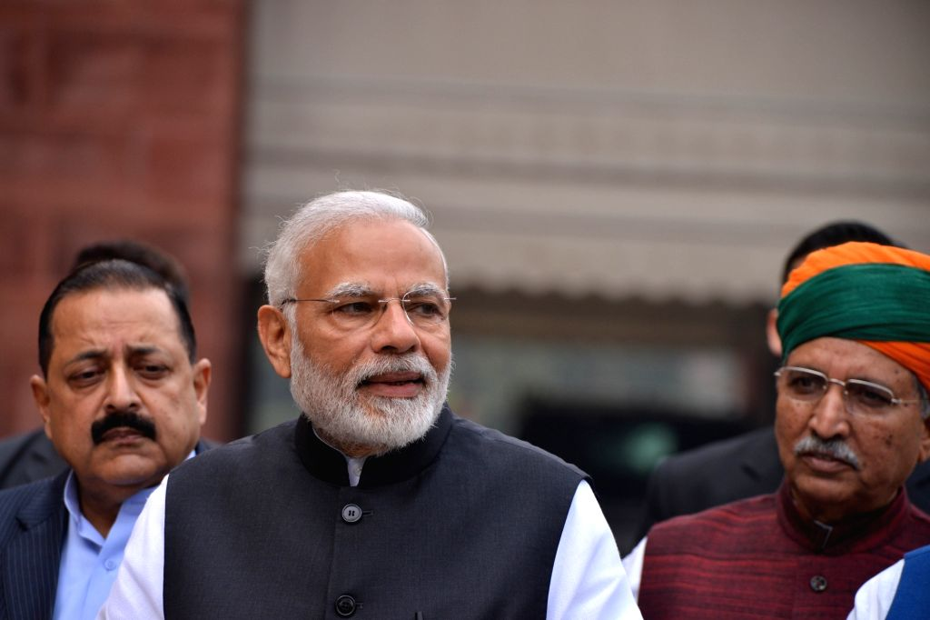 Prime Minister Narendra Modi and Union Ministers Jitendra Singh and Arjun Ram Meghwal at the winter session of Parliament in New Delhi on Dec 11, 2018. - Narendra Modi, Ministers Jitendra Singh and Arjun Ram Meghwal
