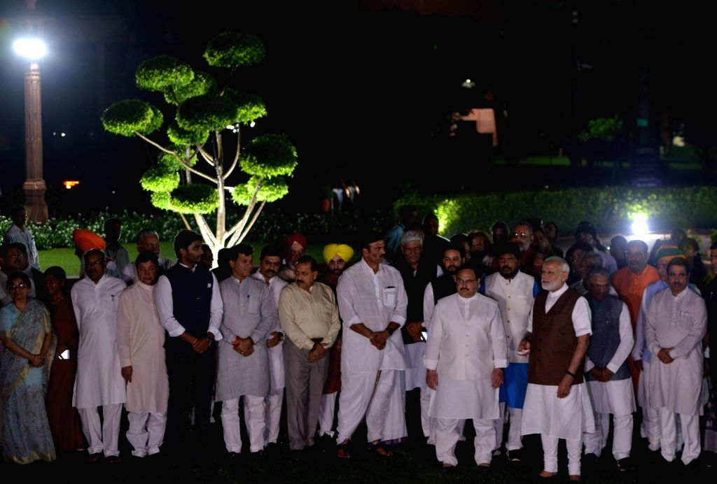 Prime Minister Narendra Modi and Union Ministers during the inauguration of the dynamic facade lighting of Parliament House in New Delhi on Aug 13, 2019. - Narendra Modi