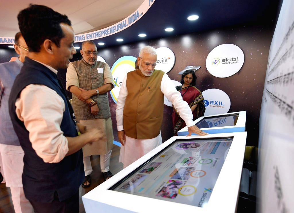 Prime Minister Narendra Modi and Union MoS Micro, Small and Medium Enterprises Giriraj Singh visit exhibition stalls, at the launch of the Support and Outreach Initiative for MSMEs, in New ... - Narendra Modi and Enterprises Giriraj Singh