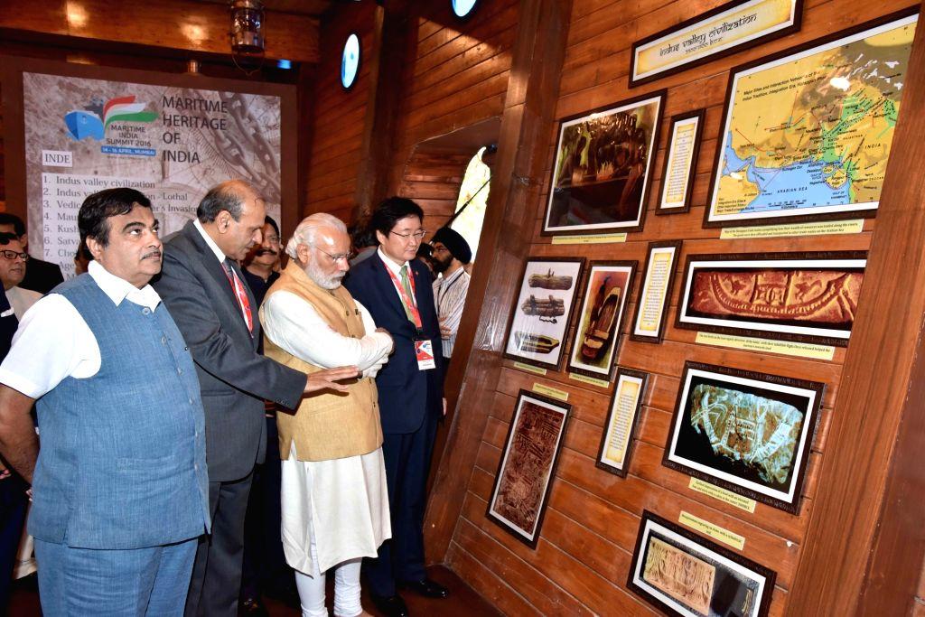 Prime Minister Narendra Modi and Union Road Transport, Highways and Shipping Minister Nitin Gadkari inaugurate Maritime Exhibition in Mumbai, on April 14, 2016. - Narendra Modi