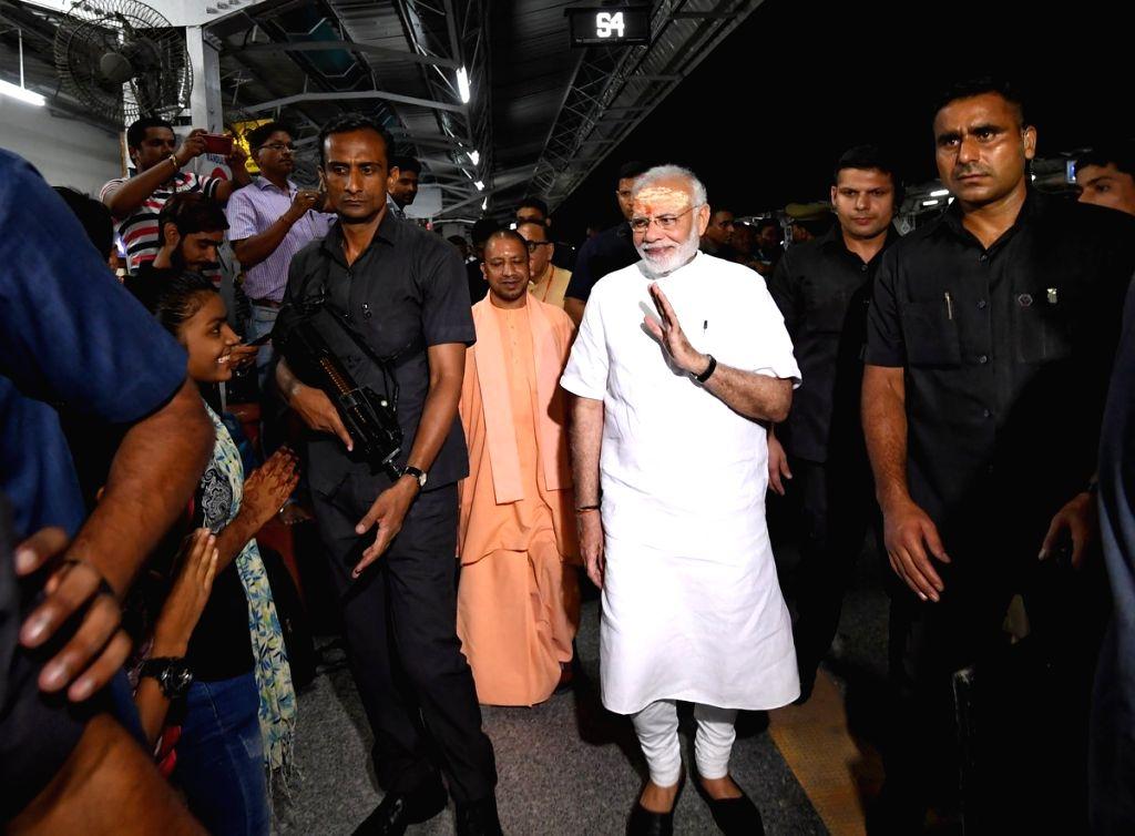 Prime Minister Narendra Modi and Uttar Pradesh Chief Minister Yogi Adityanath visit Manduadih Railway Station, in Varanasi, on Sept 17, 2018. - Narendra Modi