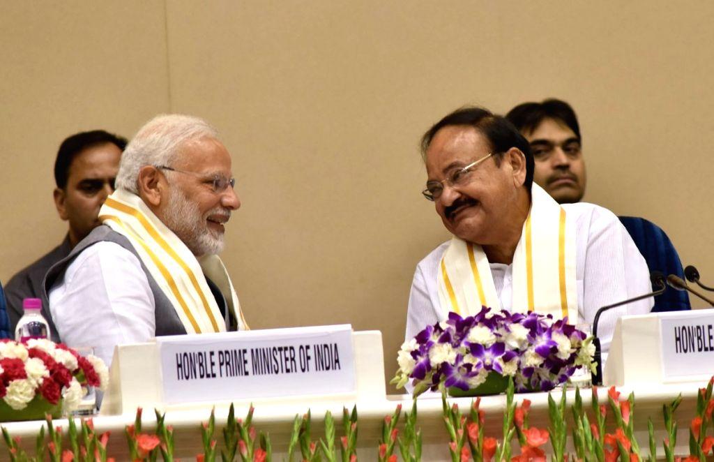 "Prime Minister Narendra Modi and Vice President and Rajya Sabha Chairman M. Venkaiah Naidu at the launch of ""Moving On... Moving Forward: A Year In Office""a book marking the ... - Narendra Modi and M. Venkaiah Naidu"